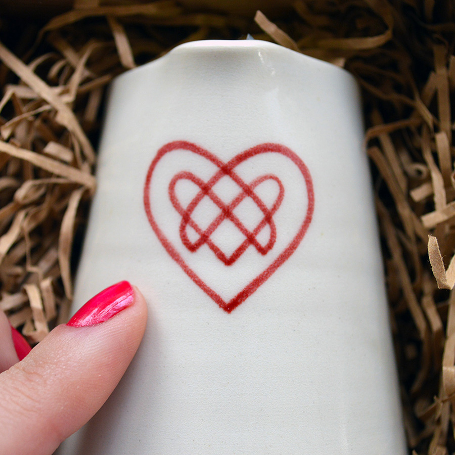 Each pourer is hand-painted with a Celtic love heart.